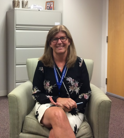 Jill Romans poses in her old office after discussing the new opportunities her new position will offer in the 2017-18 school year.