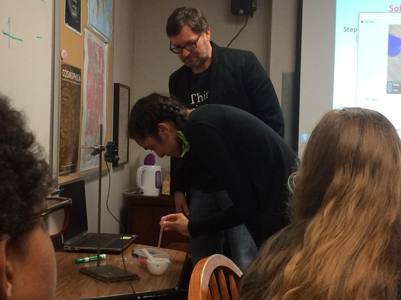 Senior Shefali Bijwadia stains a titanium dioxide coated chip with crushed raspberries to make a solar cell in University of Minnesota professor Ted Pappenfus's session.