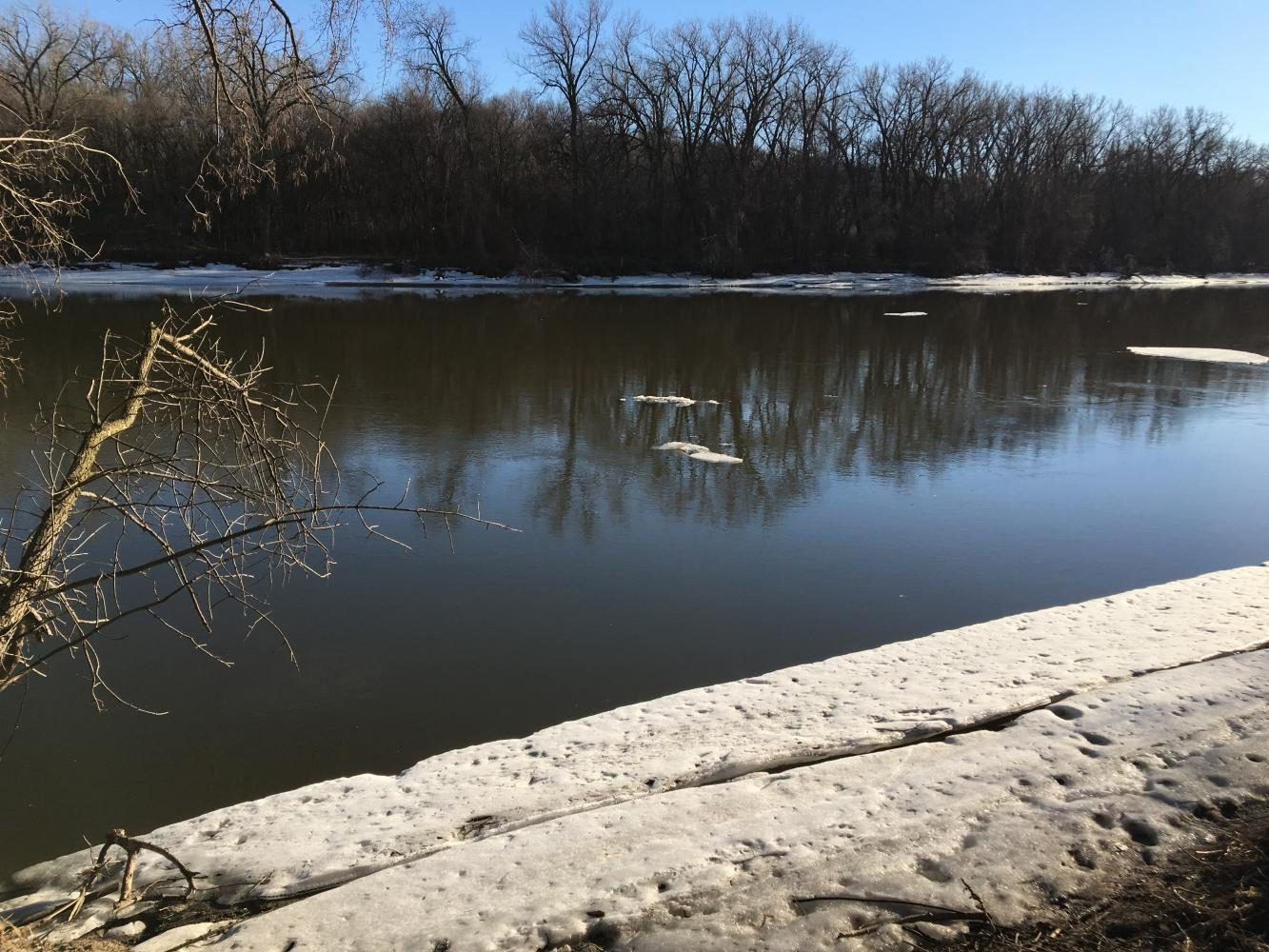 Receding ice banks along the Mississippi River suggest a trend of increased global temperatures.