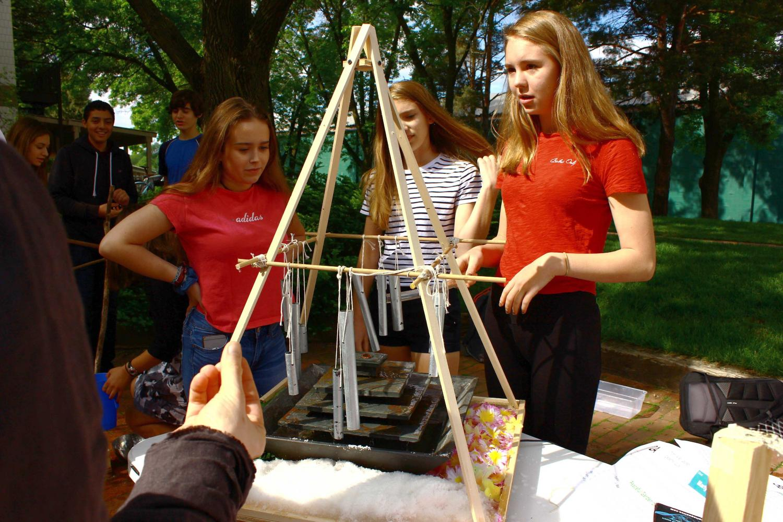 9th graders Masha Ames, Martha Sanchez, and Lauren Dieperink examine a waterfall sculpture.