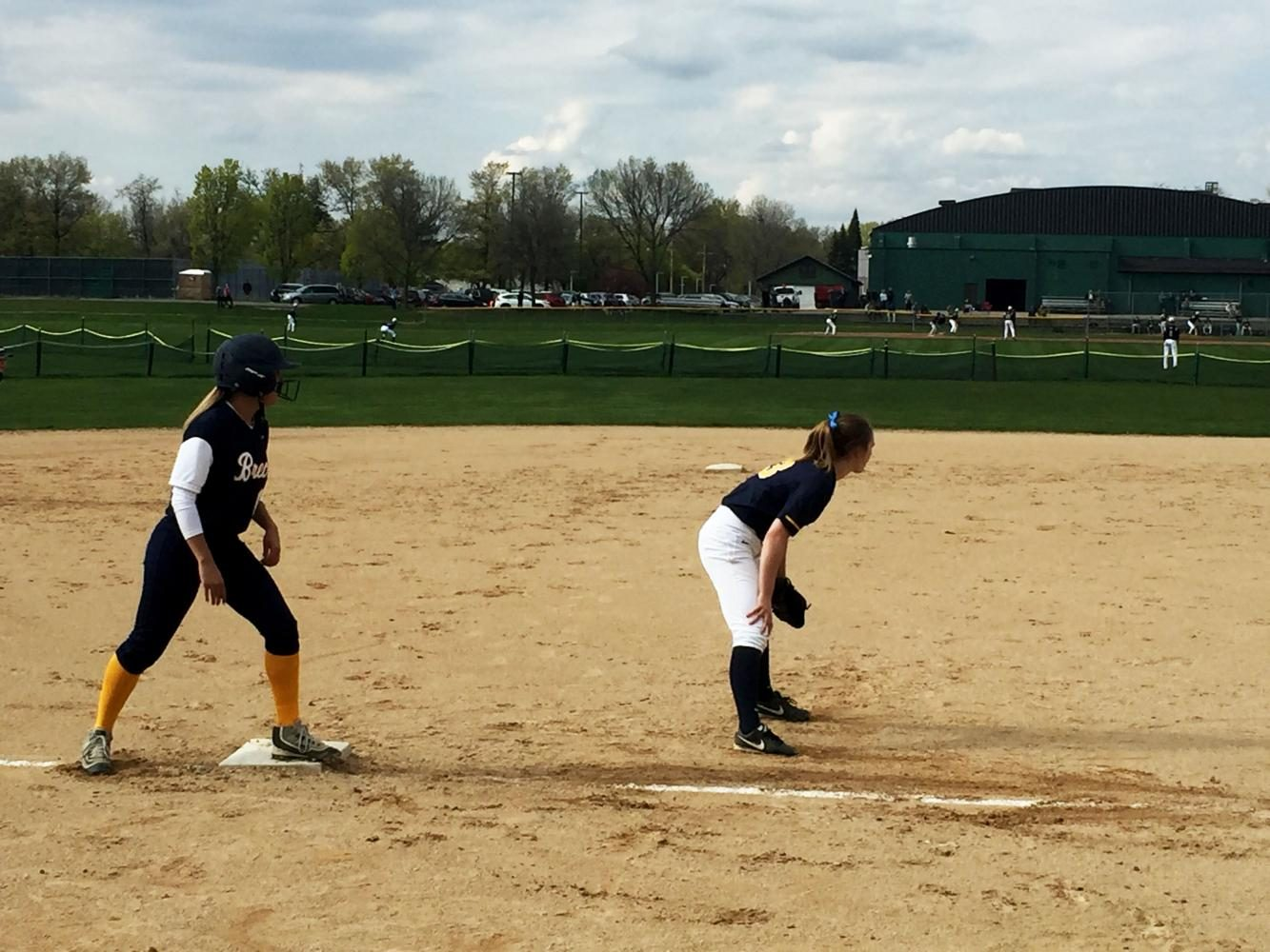 Senior+third+baseman+Justine+Miller+holds+a+Breck+player+on+base+in+the+third+inning.