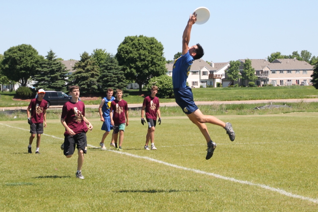 John Addicks O'Toole reaches for a high pass during the Minnesota Ultimate High School Championship. The team finished 9th in Division III.