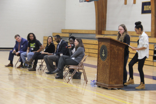 """Seniors Eva Parsons and Mansuda Arora lead the St. Paul Academy and Summit School community in a discussion about racial equality with several panelists answering student questions on Jan. 13. """"There were different opinions and it was something we could interact with,"""" senior Em Prozinski said."""