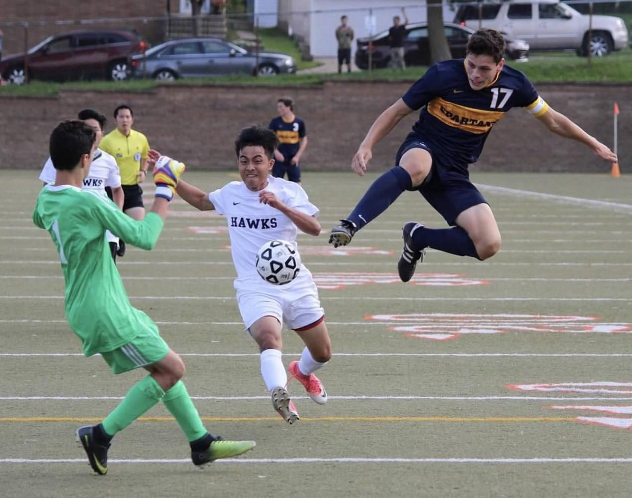 Junior Captain Eric Lagos steals ball away from mid-fielder