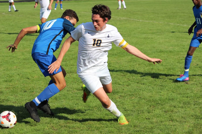 Junior captain Michael Forsgren manuevers around a defender.