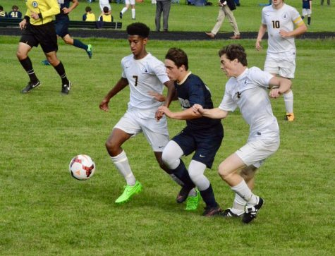 Senior Noah Solomon and junior Jasper Green defend against a Providence player.