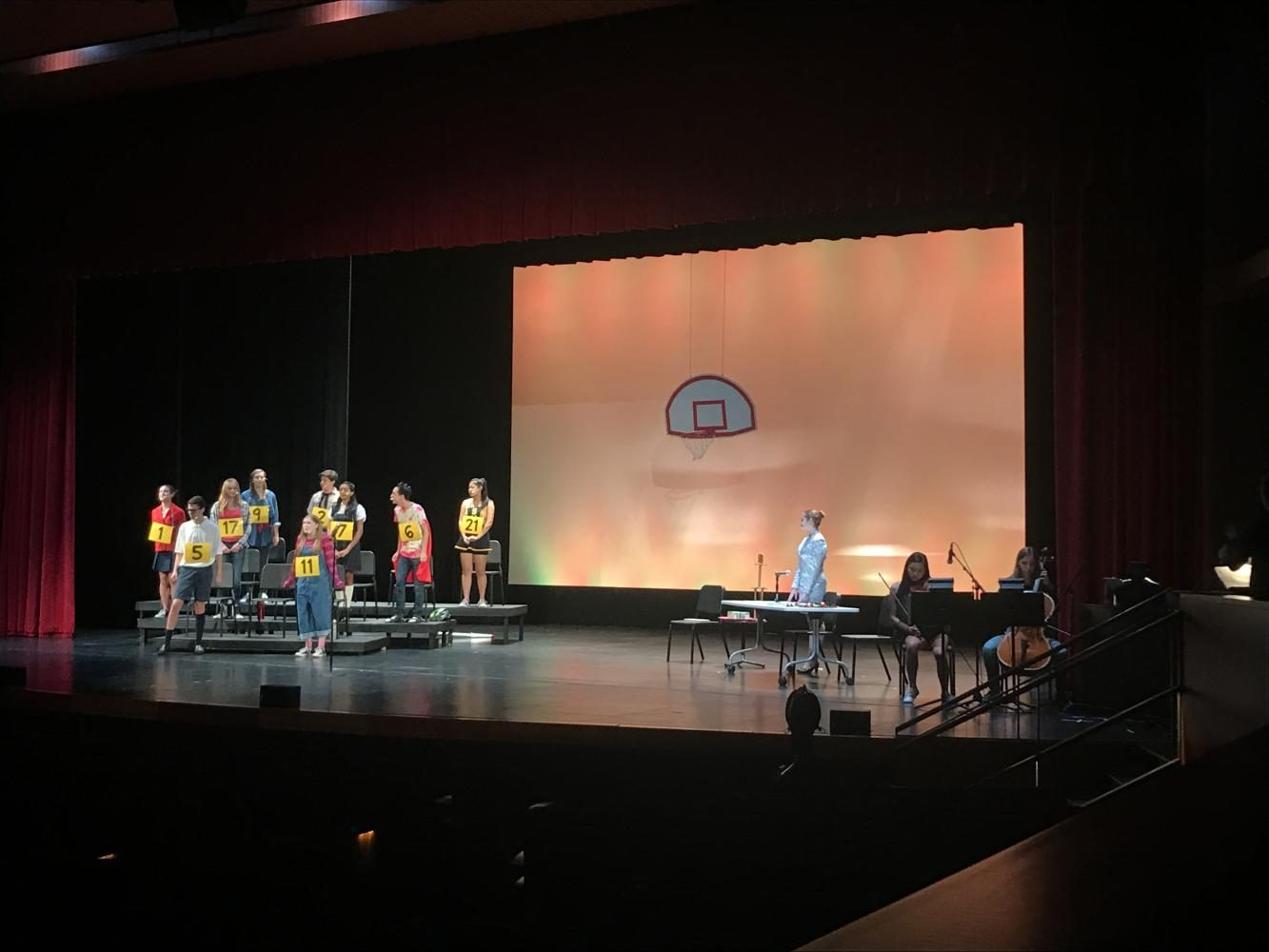 """The cast of The 25th Annual Putnam County Spelling Bee take the stage during tech week to refine their performance. """"The cast has been incredible and I'm so excited for the show; everyone has been really dedicated,"""" Harrison said. Shows run Sept. 15-16 at 7.pm."""