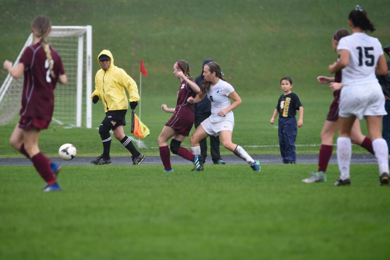 Senior Hayley Hoffman applies pressure on a Northfield defender.