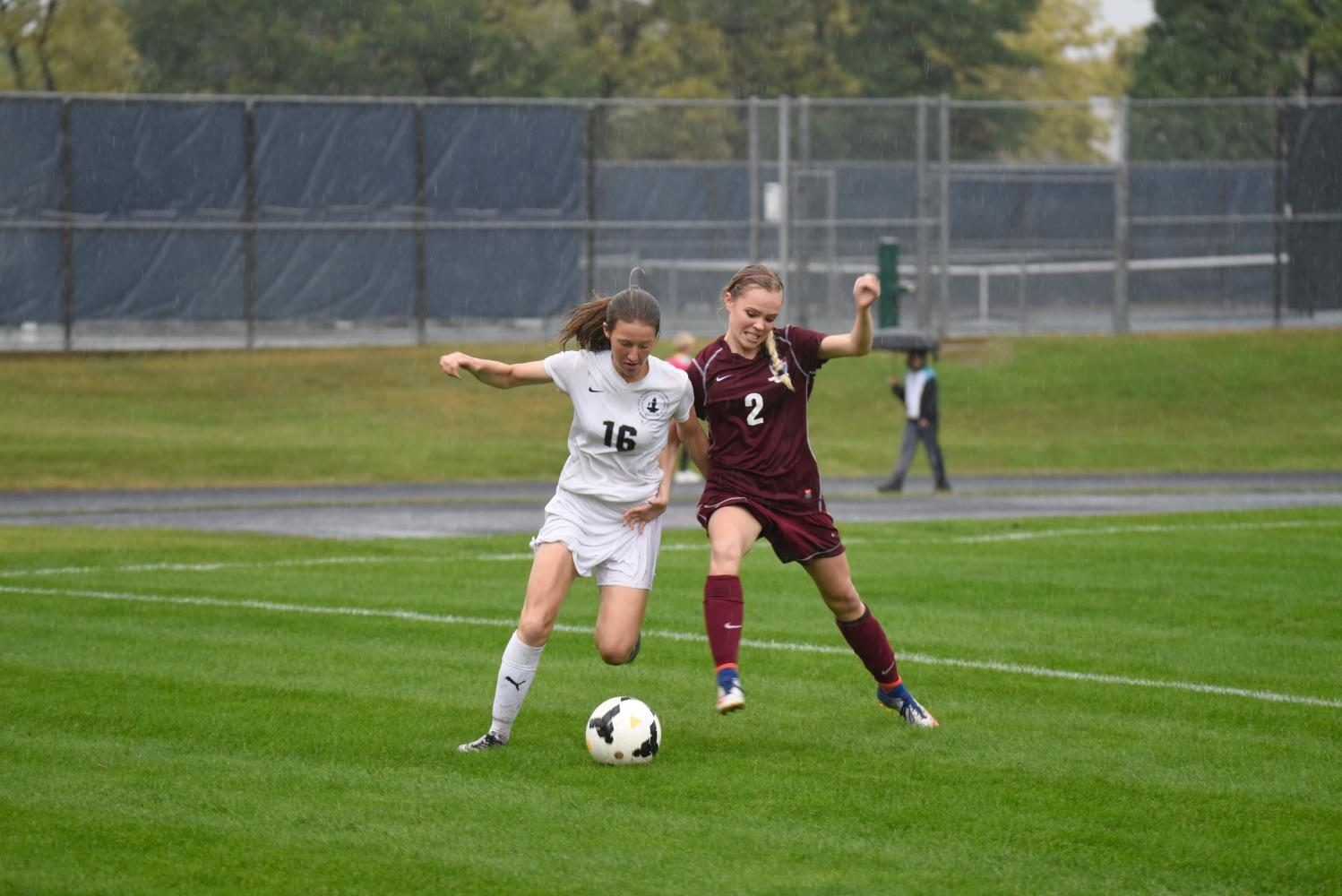 Sophomore Ayla Straub attempts to dribble down the sideline to create a chance.