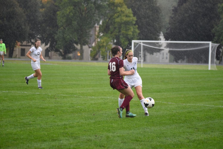 Senior Hannah Scott fights to gain possession of the ball.