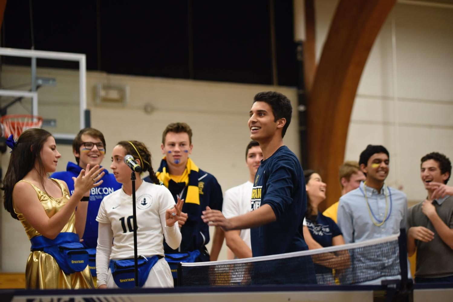 Husaam Qureishy celebrates winning a point in the ping pong championship.