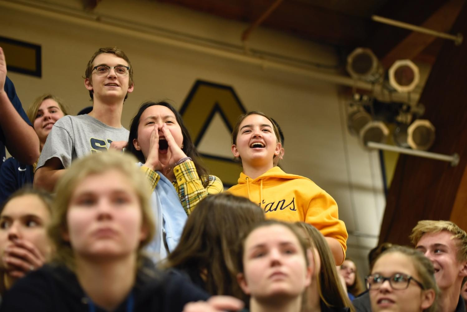 Juniors Roan Chafee, Gemma Yoo and Abby Lanz cheer for the juniors at Pep Fest.