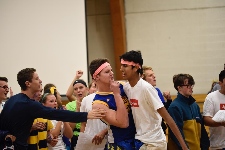 Seniors Ryan Kuntz and Rahul Dev prepare for their championship ping pong game.