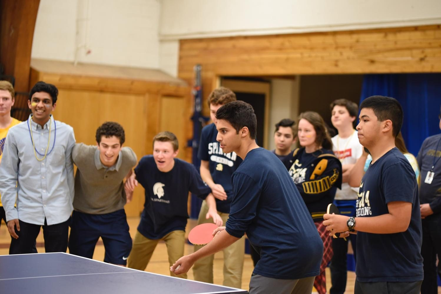 Junior Husaam Qureishy serves the ping pong in the championship game.