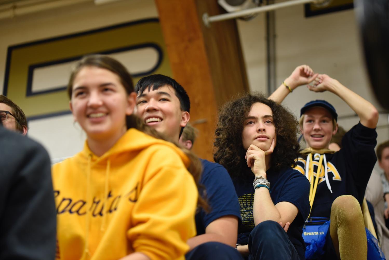Juniors Abby Lanz, Ben Putaski, Gabriel Konar-Steinberg and 9th grader Jackson Small watch Pep Fest festivities.
