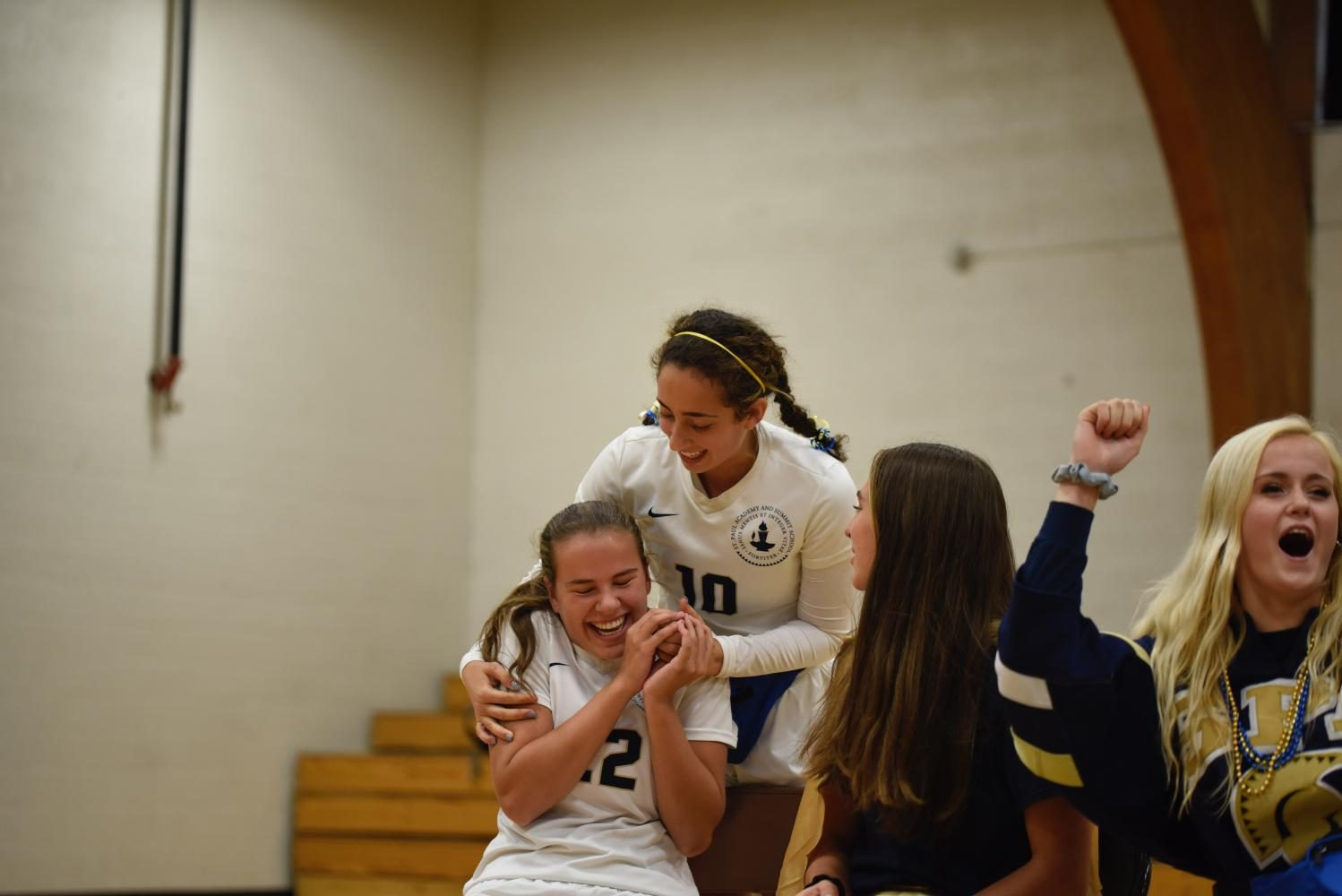 Seniors and captains of GVS Dina Moradian and Kelly Fiedler cheer during captain challenges.