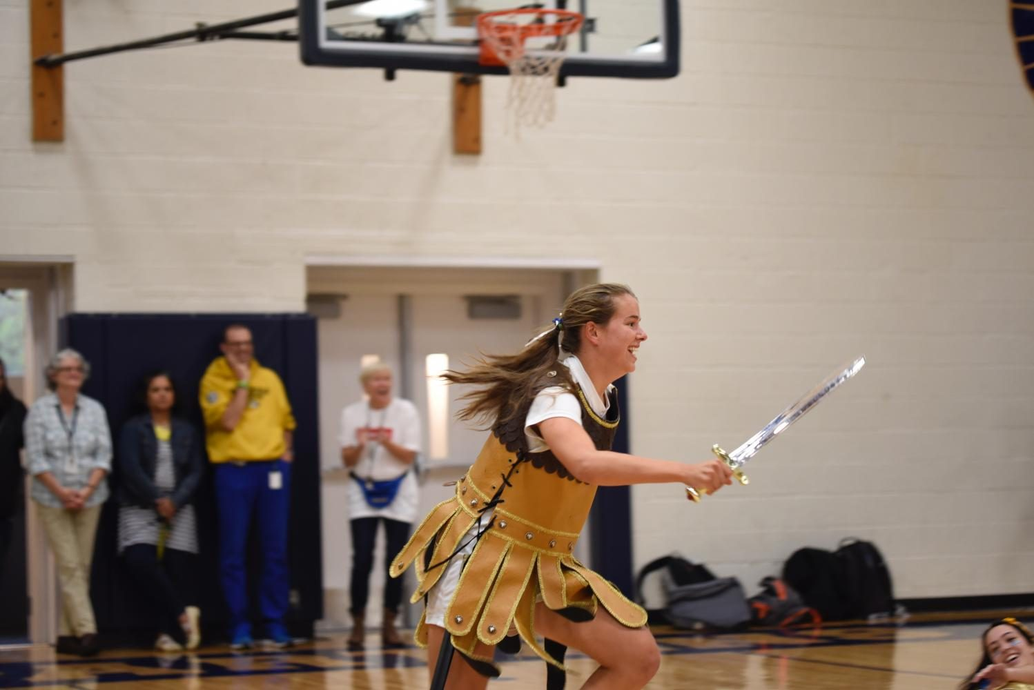 Senior and Spartan Kelly Fiedler runs in a skit performed by other students.