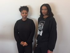 Seniors Olivia Williams-Ridge and Amina Smaller present their black outfits.