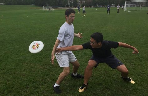 Senior Larry Chen gets low and throws the frissbee to a teammate.