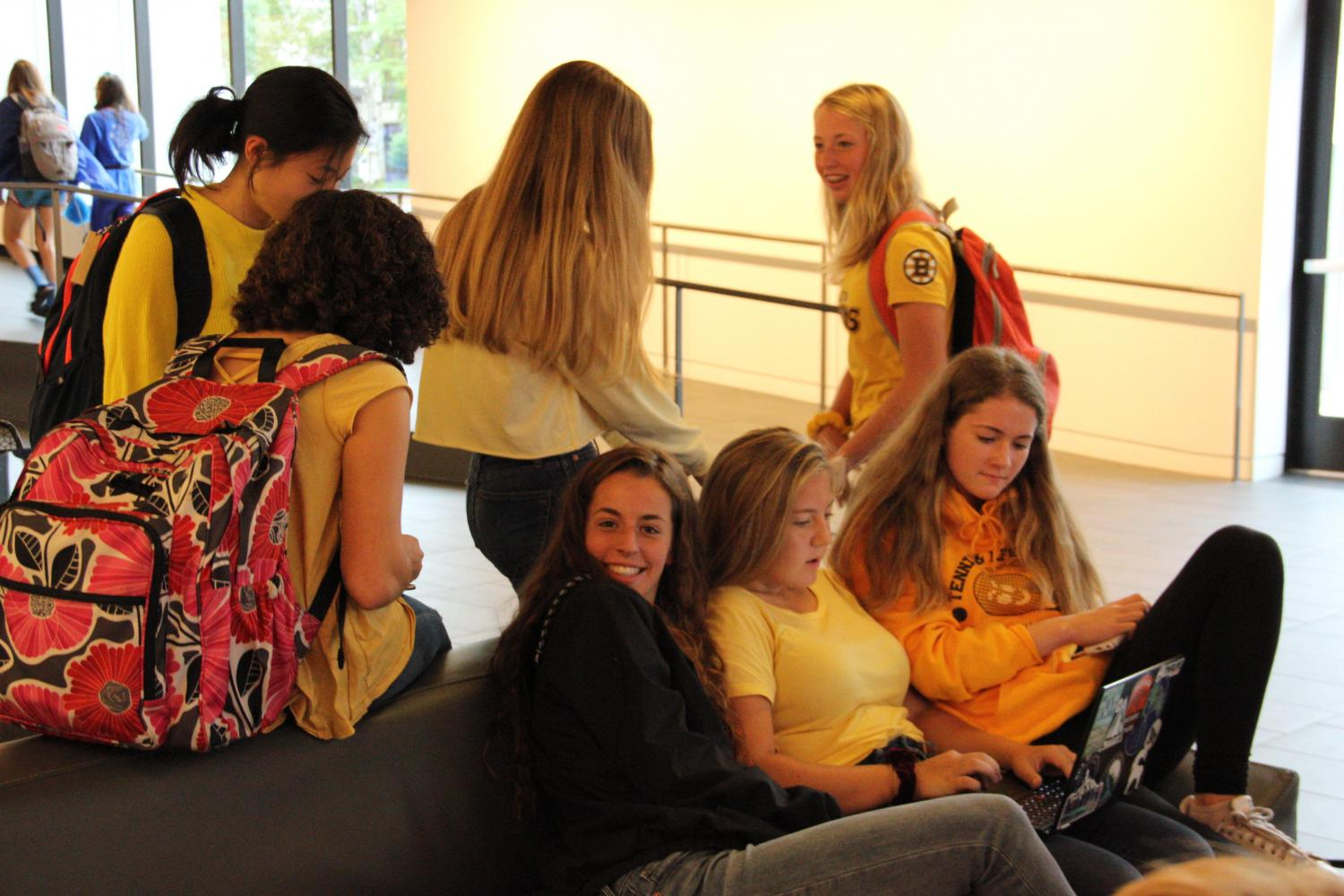Sophomores Lori Li,Libby Cohen, Martha Sanchez, Pia Schultz, Sophia Heegaard, and Clark Waltz gather in the Huss Center after the Homecoming Kick off Assembly.