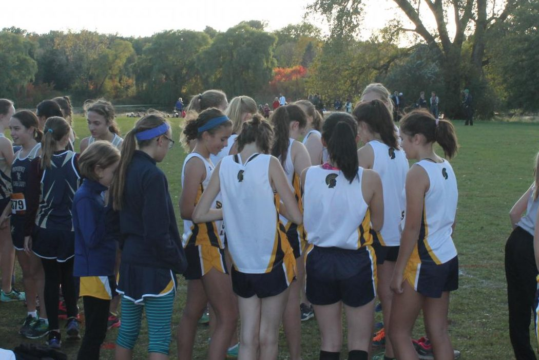The Cross Country team comes together in a huddle before the race.
