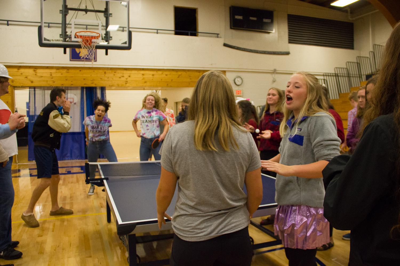 Sophmores Pia Shultz and Katherine Beran discuss strategy play while their opposing team celebrates winning a point.