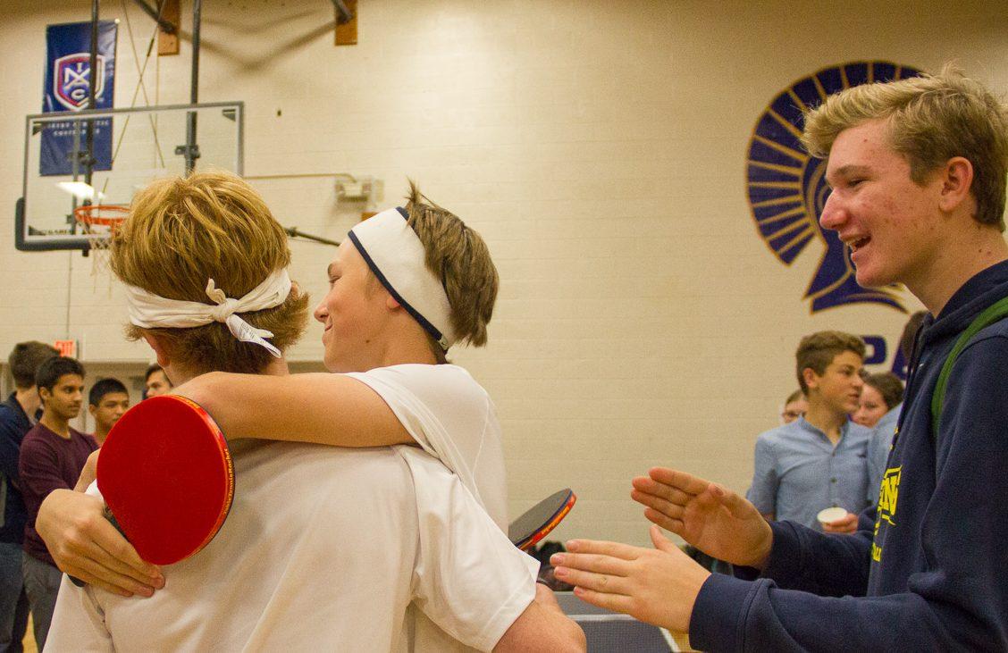 Students celebrate winning their match.