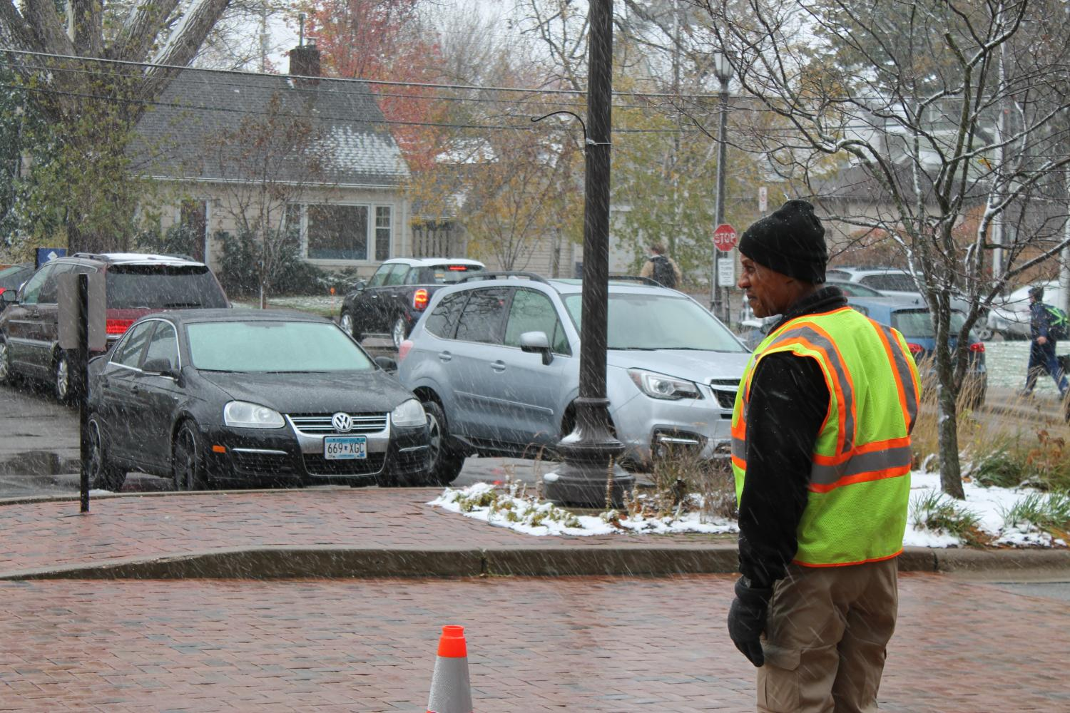 A+security+officer+waits+outside+in+the+morning+to+monitor+the+traffic+and+safety+of+the+students.
