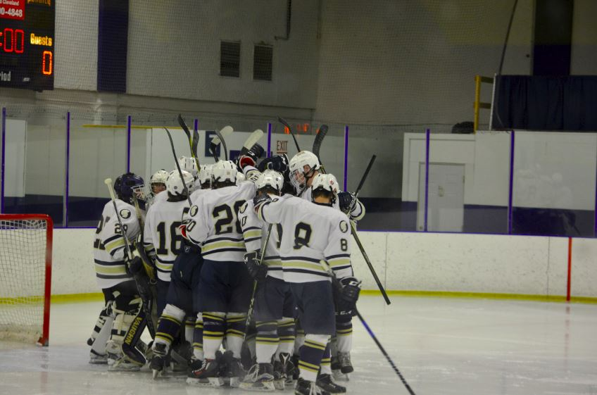 """The Boys Hockey team huddles in Drake. """"For [the Boys Hockey team], it's kind of like a collection of memories,"""