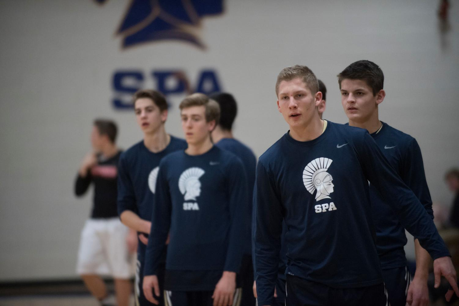 "SHOUT OUT. To get through a long season, the boys basketball team bonds on and off the court. ""Just spending so much time with my best friends is what makes the season so much fun,"" captain Gus Grunau said."