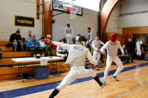 CONCENTRATION. The fencing team grows from past seasons culturally, adapting to each new coach as they come in.