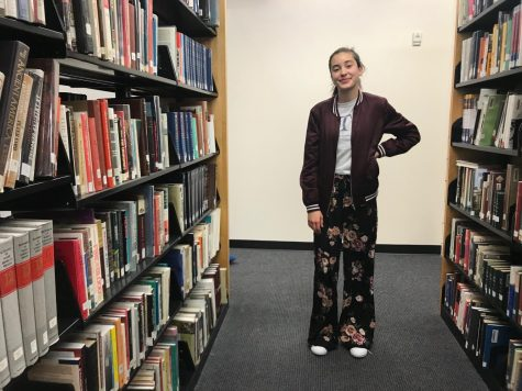 Junior Nora Povejsil wears a jacket from Forever 21, a t-shirt from Rock the Garden, pants from Target, and Adidas shoes.