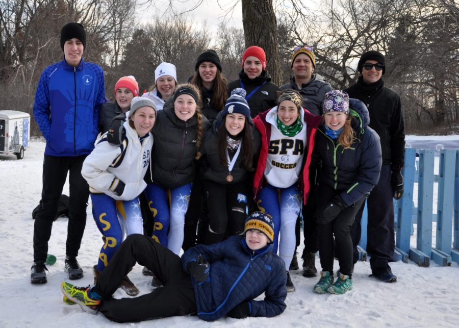 "SOCCER OR SKI? In between races, the Nordic Ski team is known to play games as a group: ""We like to play ski soccer,"" captain Val Hart said, where we just basically play soccer in our ski boots and it's very amusing."""