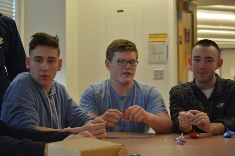 Juniors Ryan Moore, Reuben Vizelman and Joe Kase play a game with gelt.