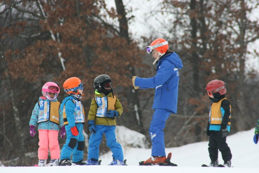 Senior Marlee Baron works with a group of beginning skiers at Afton Alps. She said that lessons are the best part of her job.