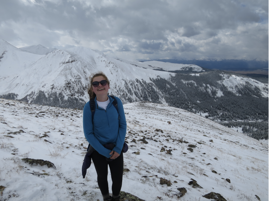 Junior Betsy Romans summits a mountain after a long day of hiking.