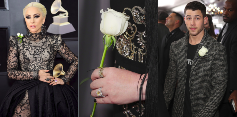 Grammy attendees Lady Gaga and Nick Jonas wear white roses to symbolize their support of women's rights.