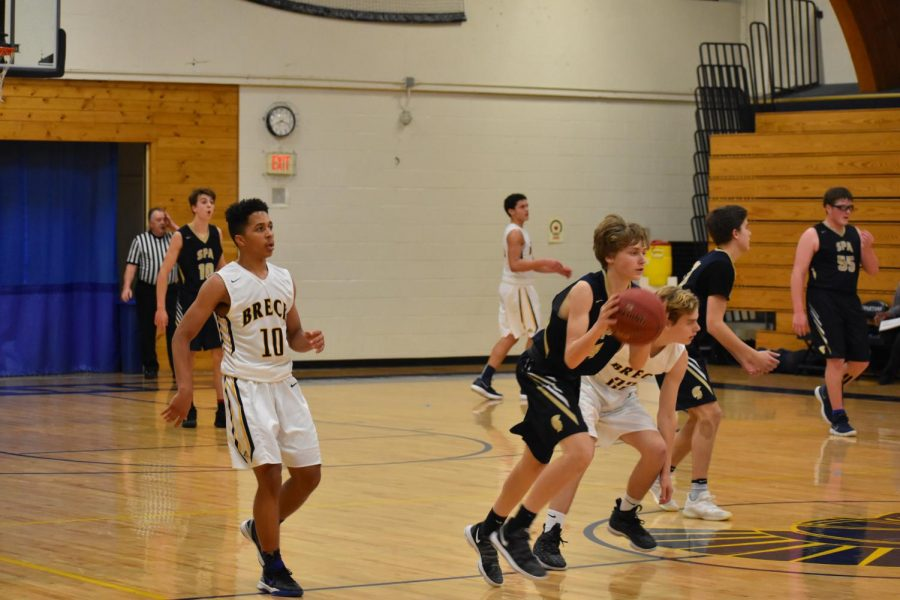Ninth+grader+Adam+Holod+about+to+score+a+3+pointer.+