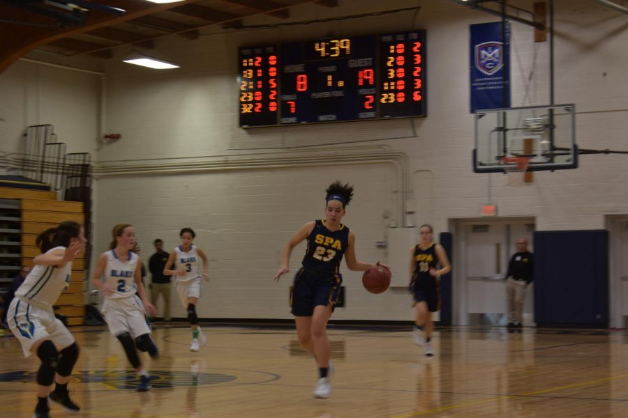 Senior Izzy Denny takes the ball from a Blake player.