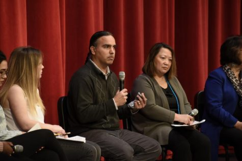 John Hunter, father of a student in third grade at St. Paul Academy and a representative of Native American teaching, speaks on challenging the community to make corrections.