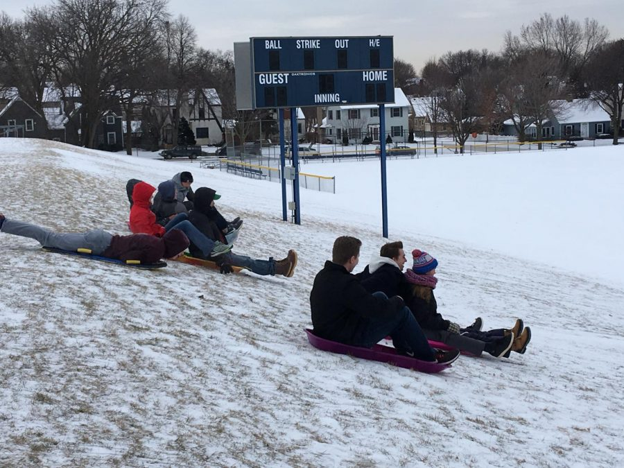 Students gathered at the upper field to sled during X-period on Jan. 4. Outdoors Club hosted the event.