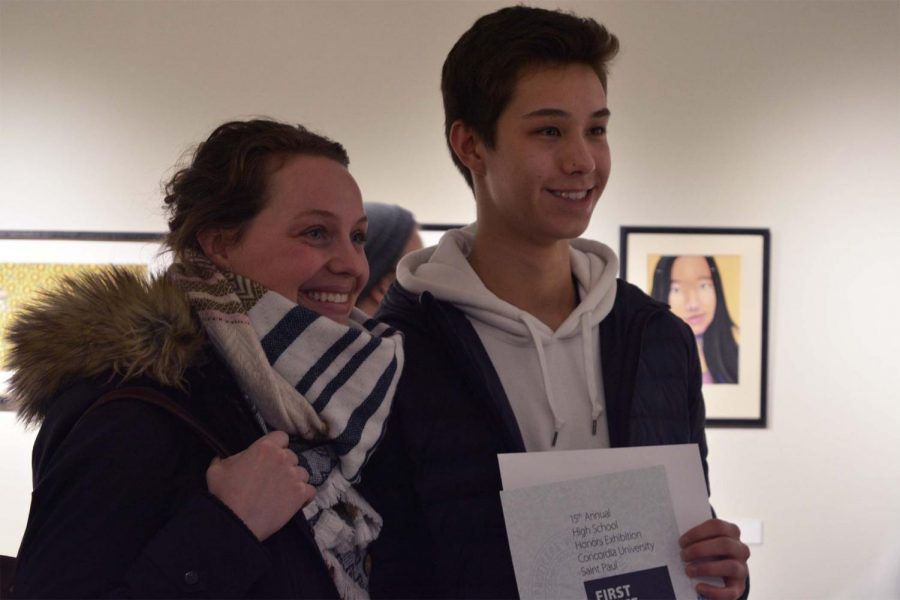 Junior Koji Gutzmann and US Photography and Video Arts teacher Stefanie Motta posing for a congratulatory photo.