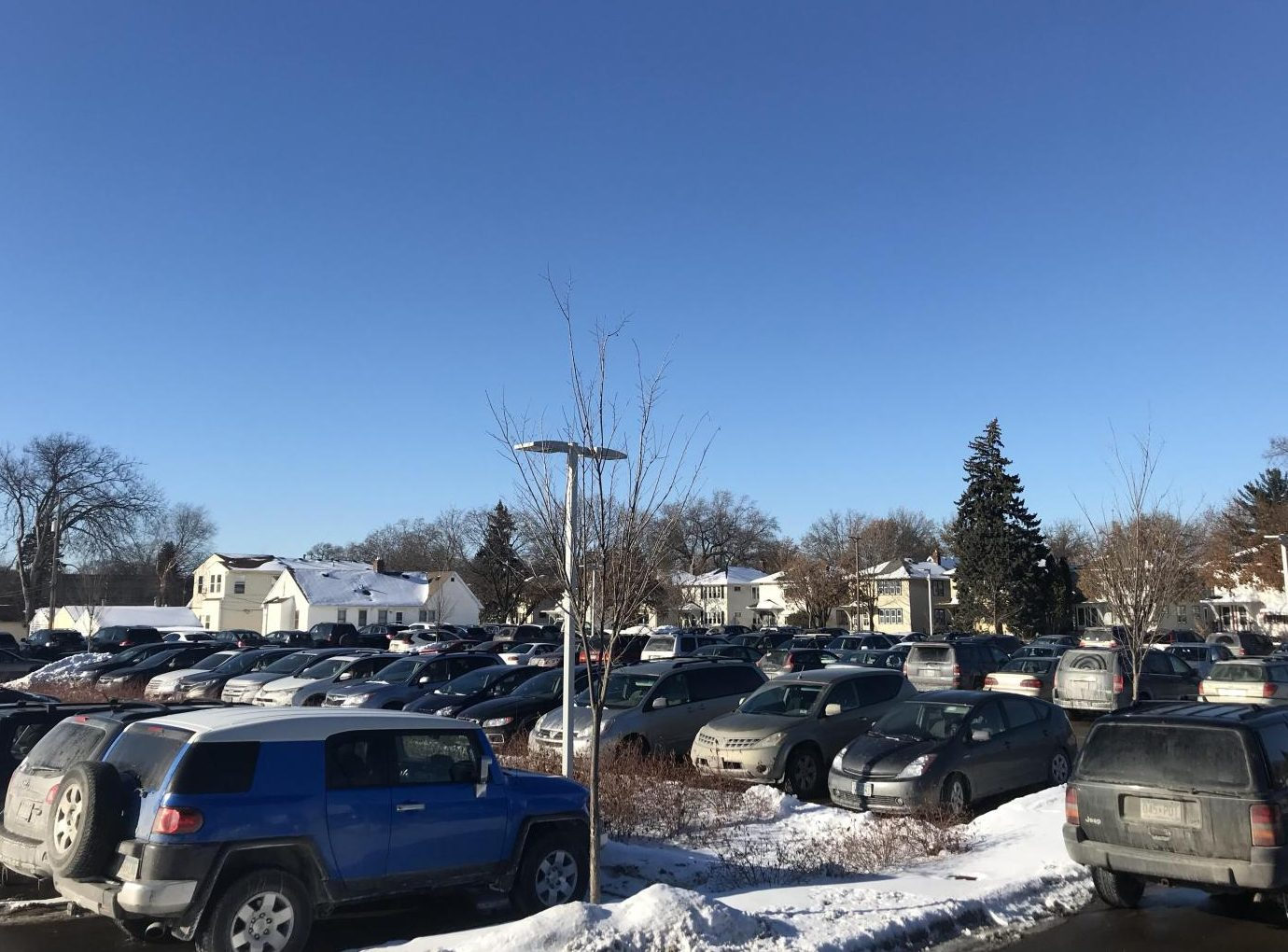 It's hard to find a parking space on campus, especially when street parking is closed for snow removal. Carpooling could solve this problem.