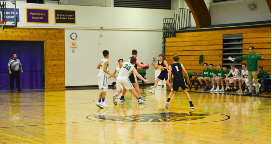 Moore protects the ball and junior Andrew Johnson ready to recieve the ball.