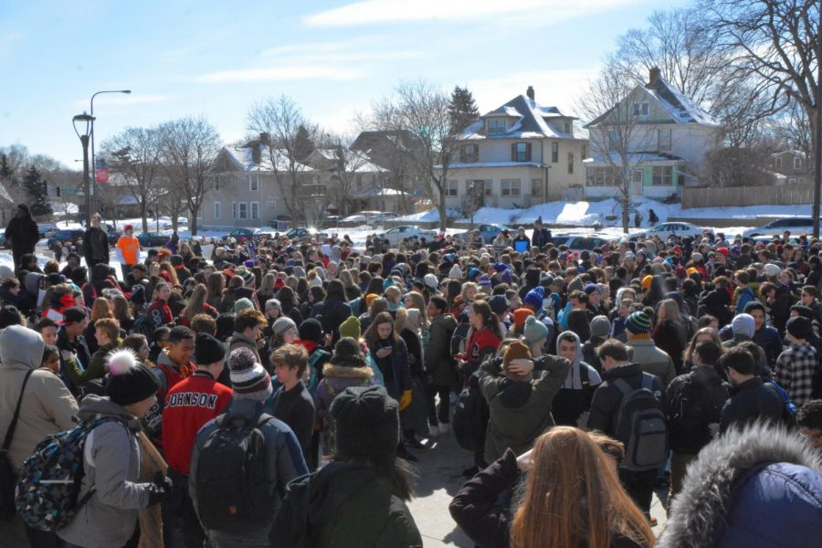 Thousands+of+students+gather+in+the+parking+lot+of+Saint+Paul+Central+high+school.