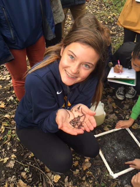 Junior Bailey Donovan holds worms that she collected for a sample.