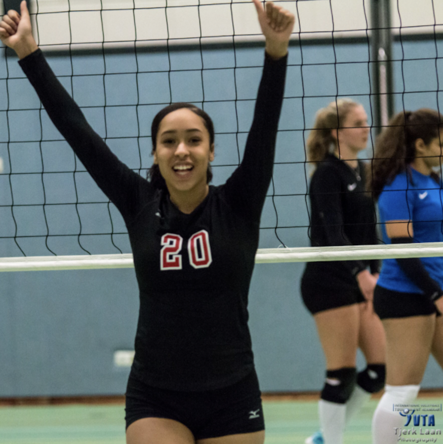 CELEBRATE. Sophomore Arie Walker plays in a volleyball game during a tournament in Europe.
