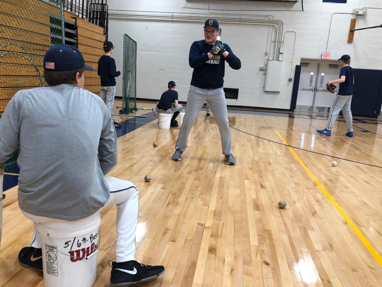 Senior Ryan Moore works on his hitting mechanics during a practice last season.