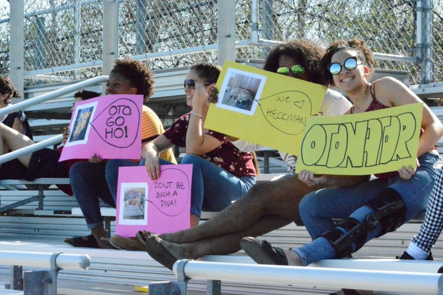 Students support the spring Ultimate Frisbee team on the bleachers beside Lang field.