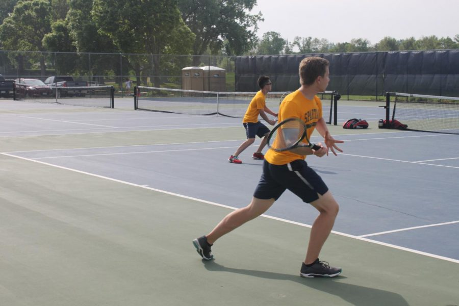 Senior Duke Nguyen returns his opponents serve.